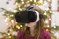 Girl using Virtual Reality Glasses at Christmas time - SARF03132