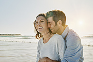 Laughing couple on the beach - RORF00547