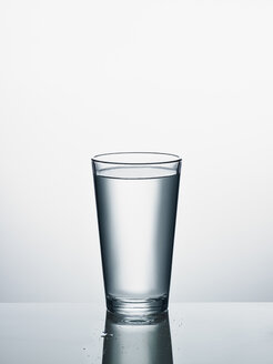 Glass of water in front of white background - RORF00571