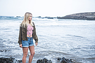 Spain, Tenerife, young blond woman on the beach - SIPF01360