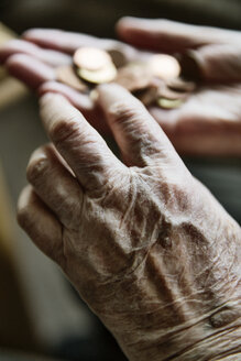 Senior woman's hands with coins - JATF00944