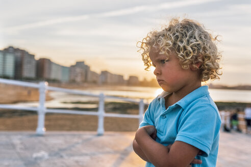 Angry little boy on the beach at sunset - MGOF02826