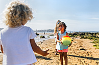 Children playing with ball on the beach - MGOF02836