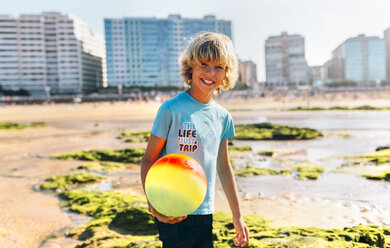 Portrait of blond boy with ball on the beach - MGOF02842