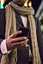 Close-up of man using his cell phone at night - ABZF01822