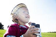 Girl with binoculars on meadow - FSF00685