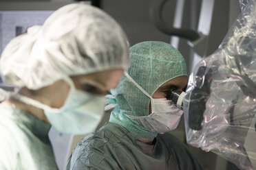 Neurosurgeon and operating room nurse during an operation - MWEF00115