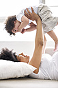 Pregnant woman playing with her little son at home - FSF00708