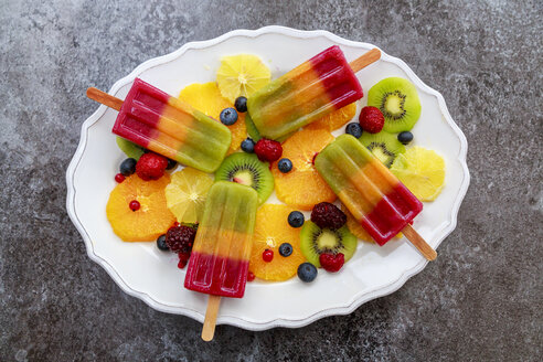 Plate of homemade fruit smoothie ice lollies - SARF03140