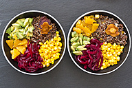 Two lunch bowls of red quinoa, beetroot, corn, avocado, orange and vegetable chips - SARF03146