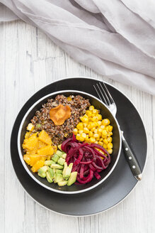 Lunch bowl of red quinoa, beetroot, corn, avocado, orange and vegetable chips - SARF03149