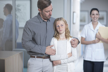 Father guiding sick daughter in hospital - ZEF12603