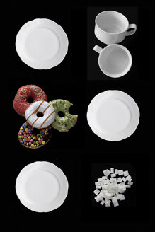 White dishes, doughnuts and sugar cubes on black ground - HSTF00044