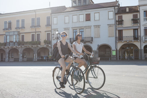 Italy, Padua, two young tourists riding bicycle - ALBF00092
