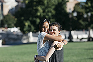 Portrait of two best friends hugging each other in the park - ALBF00110