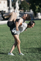 Two best friends having fun together  in the park - ALBF00113