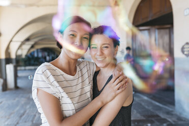 Two young women playing with soap bubbles - ALBF00122