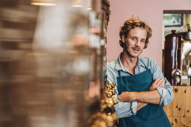 Portrait of confident coffee roaster in his shop - KNSF00872
