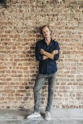 Portrait of man at brick wall - KNSF00923