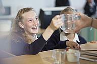 Teenage girls in high school cooking class - ZEF12633