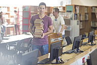 High school student carrying stack of books - ZEF12669