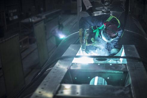 Man welding steel in factory - ZEF12701