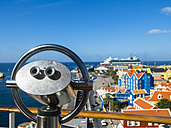 Curacao, Willemstad, Punda, coin-operated binocular and colorful houses at waterfront promenade - AMF05237