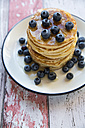 Dish with pile of pancakes and blueberries with maple sirup - SARF03166