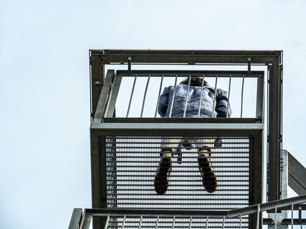 Worms-eye view of woman on an observation deck - EJWF00837