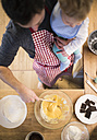 Father and baby boy in kitchen baking a cake - HAPF01332