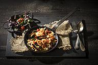 Spaghetti Frutti di Mare with leaf spinach lettuce dish - MAEF12112
