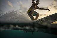 Indonesia, Bali, surfer at sunset - KNTF00630