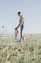 Netherlands, Schiermonnikoog, mother walking with little daughter on a meadow - DWF00274