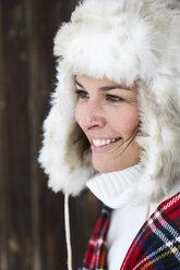 Portrait of smiling woman wearing fur cap in winter - FSF00729