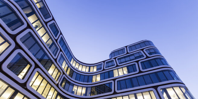 Facade of lighted office building in the evening - WDF03863