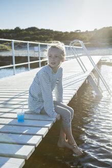 Girl sitting on jetty looking away - OJF00187