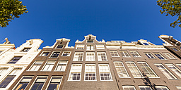 Netherlands, Amsterdam, row of facades of canal houses at Prinsengracht - WDF03867