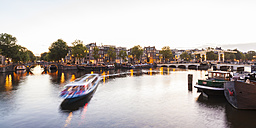 Netherlands, Amsterdam, view to the old town and Magere Brug with Amstel River in the foreground - WDF03882
