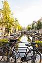 Netherlands, Amsterdam, parked Dutch roadster on bridge - WDF03885