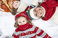 Mother and daughters having fun in winter - FSF00773