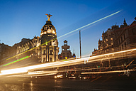 Spain, Madrid, Gran Via Street and Metropolis building at night - KIJ01180