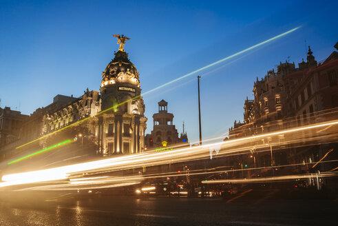 Spain, Madrid, Gran Via Street and Metropolis building at night - KIJ01180