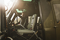 Pilot in cockpit of a helicopter - MADF01307