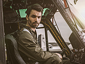 Portrait of pilot in cockpit of a helicopter - MADF01313