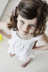 Cheaky little girl standing with hands on hips - JATF00970