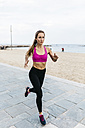 Young woman running at the beach - GIOF01733