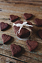 Heart-shaped chocolate shortbreads on wood - GIOF01769