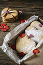 Cardboard box of three heart-shaped shortbreads sprinkled with icing sugar - GIOF01790
