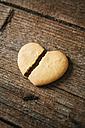 Broken heart-shaped Shortbread on wood - GIOF01796
