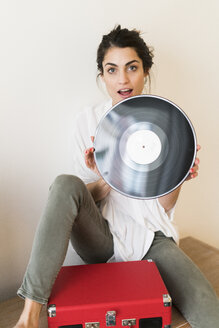 Portrait of woman with record and record player - KKAF00397